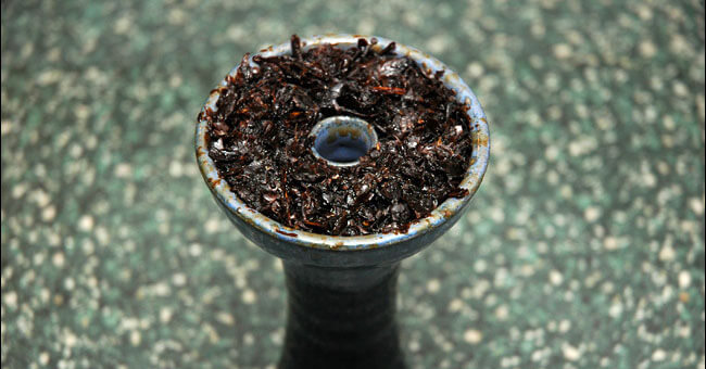Из-за некачественного табака в кальяне может болеть голова.