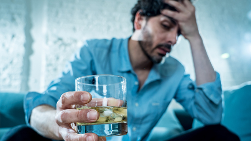 Latin businessman drunk and depressed at home in alcoholic conce